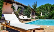 Comfortable, wooden sunbed to relax by the pool