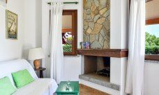 Fireplace inside opposite the sofa