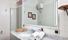 Bath west wing with a big mirror