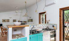 Kitchen with stove and washing machine