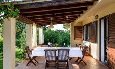 Roofed terrace with dining table