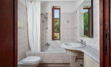Bathroom 1 with window and bathtube