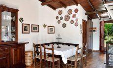 Dining area inside with sardinian decoration