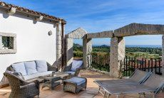 Terrace with outside sofa, sunbeds and sea view, Li Conchi 21, Cala Sinzias