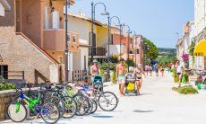 Strolling on the promenade in Vignola Mare