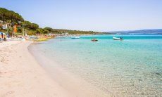 White sand and crystal clear water of the beach Le Bombarde Alghero