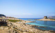 View from the coast onto the spanish tower of La Pelosa, Stintino