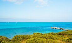 Jetty in the blue sea of La Pelosa, Stintino