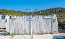 Showers on the beach of Golfo Aranci