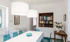 Light and spacy dining room with big dining table