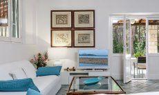 Elegant sofa corner with TV and door to the terrace and garden