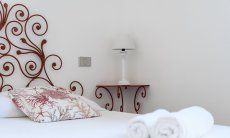 Decorations in wrought iron on the bed and bed table of Su Faru 2 Pula