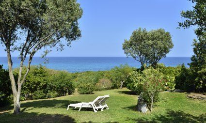 View across the wide garden towards the blue sea